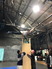 Mark Graham hand balancing on stretcher in rehearsal